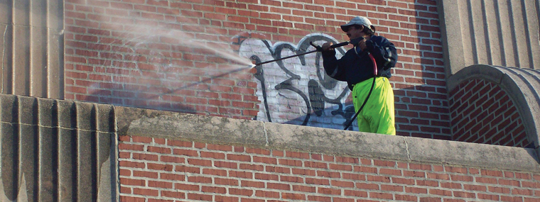 Jet-Wash-Cleaning-Graffiti-from-wall-surrey